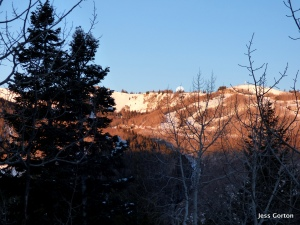 The moon sets over that mountain early in the morning.