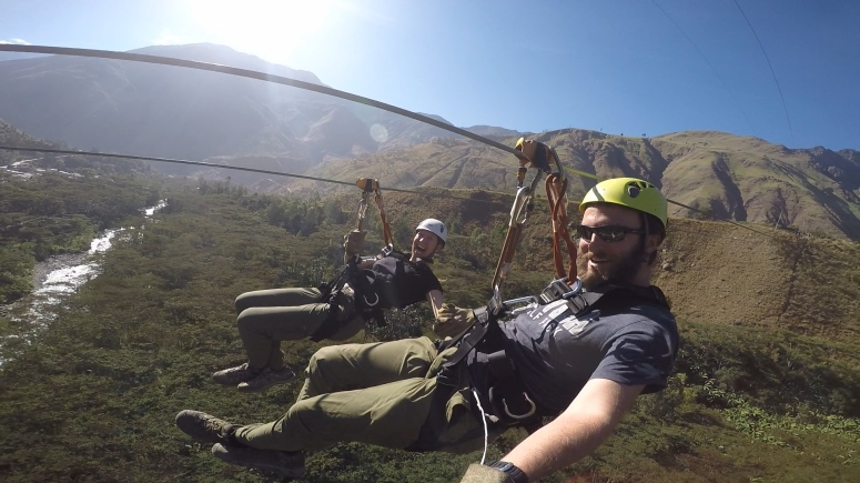 Chase and I fly through the air, zip-lining 300 meters above the canopy of trees
