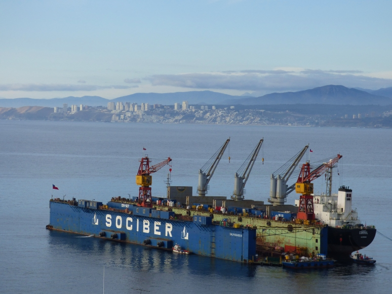 A ship comes in to port with the skyline of Viña del Mar lies in the backdrop