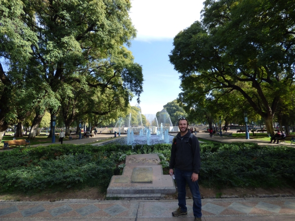 Chase stands in front of the  fountains at Plaza Independencia
