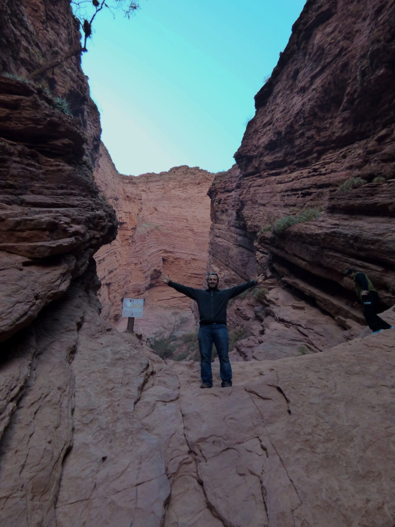 Chase stands at the furthest point allowed to hike and climb in to the canyon.