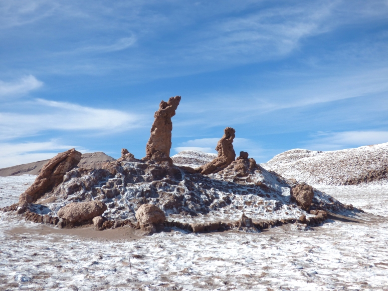 The Tres Marias in the Valle De La Luna. One prays, one lifts her hands to the sky, and the third watches the other two.