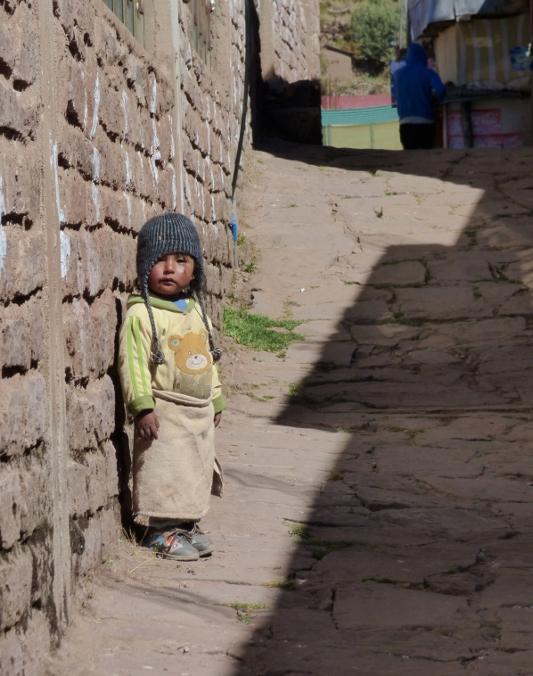 As we walked through town, this little girl just stood and stared at us, never moving, never making a sound.