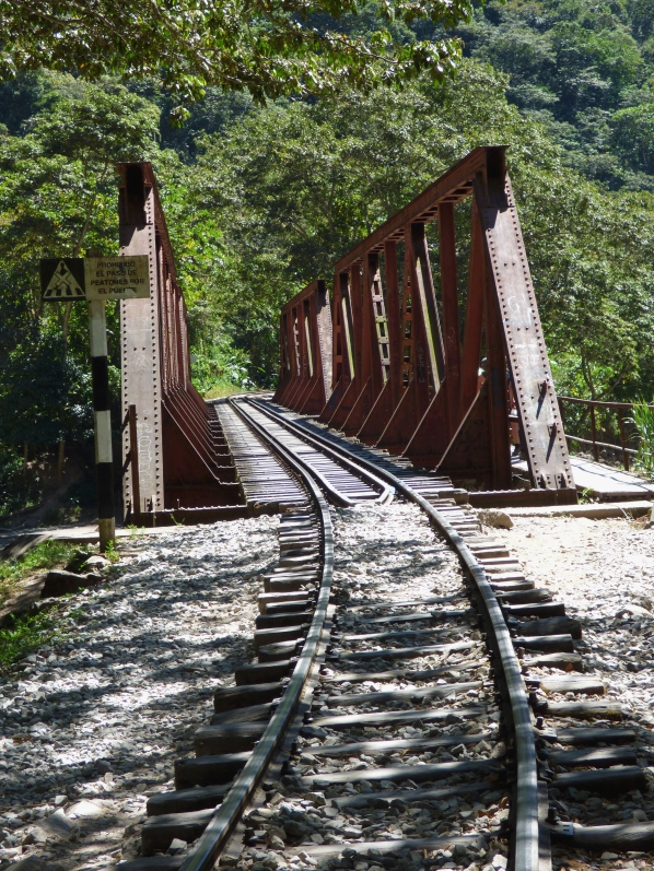 The train tracks curve over a bridge towards Machu Picchu... only 3 hours left to hike...