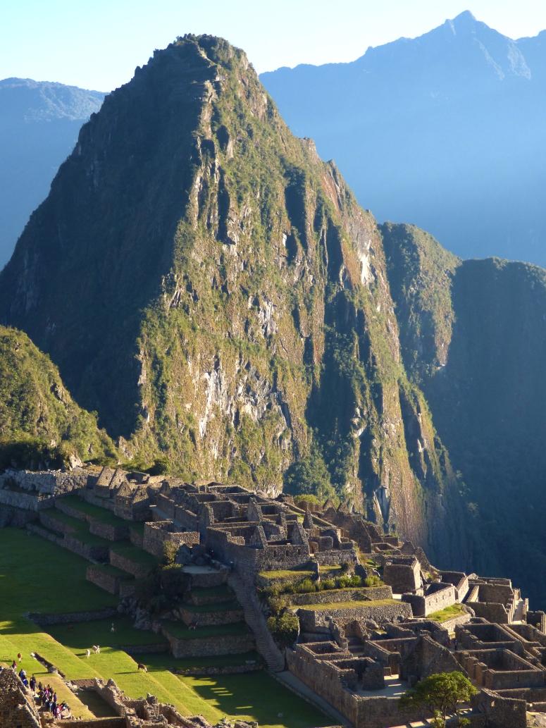 Wayna Picchu stands opposite Machu Picchu mountain above the platue that Machu Picchu stands on.